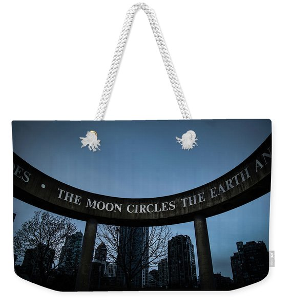 Weekender Tote Bag featuring the photograph The Moon Circle by Juan Contreras