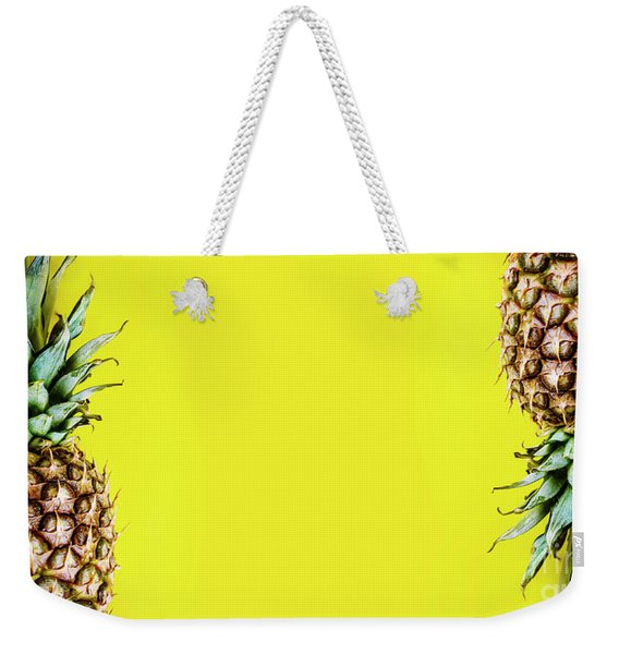 Top View Of Pineapple Border On Bright Yellow Background. Vivid  Weekender Tote Bag