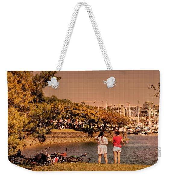 Weekender Tote Bag featuring the photograph Two Girls by Juan Contreras