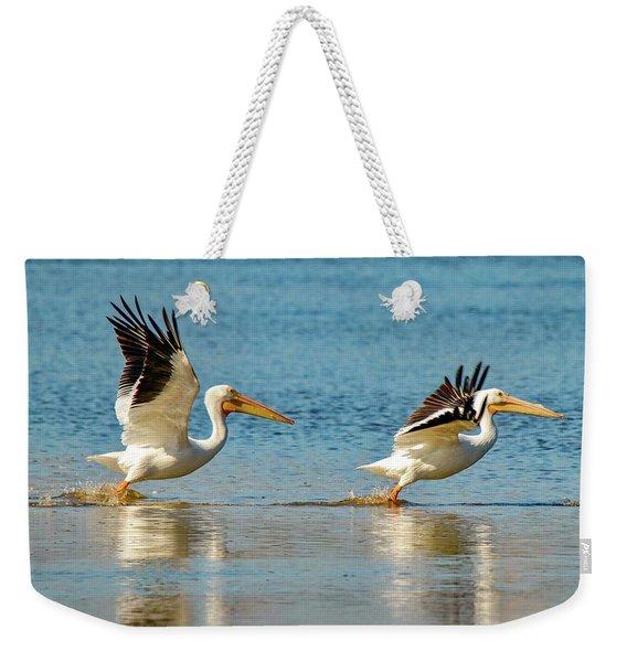 Two Pelicans Taking Off Weekender Tote Bag