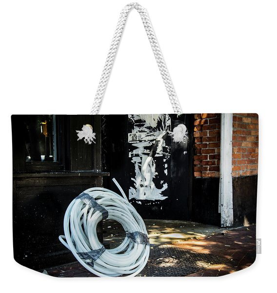 Weekender Tote Bag featuring the photograph Urbanscape by Juan Contreras