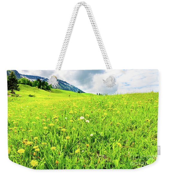 Vivid Green Spring Mountain Meadow Extends To The Uphill  Mountains. Weekender Tote Bag