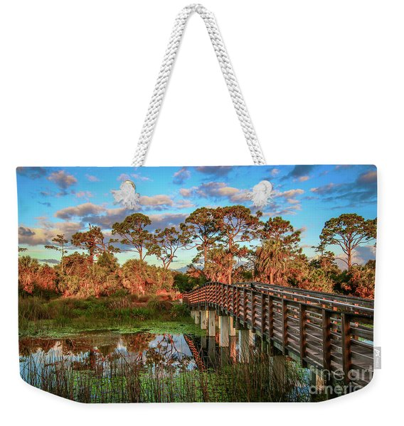 Weekender Tote Bag featuring the photograph Winding Waters Boardwalk by Tom Claud