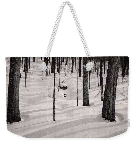 Weekender Tote Bag featuring the photograph Winter Light In The Forest by Jeff Sinon