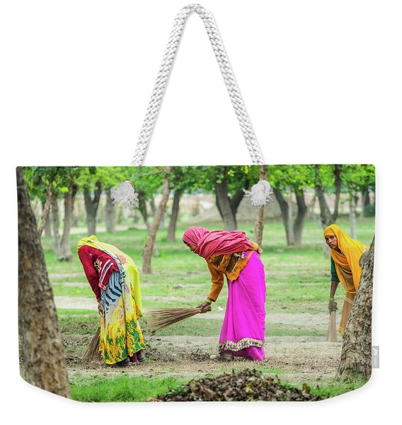 Weekender Tote Bag featuring the photograph Woman In The Garden by Robin Zygelman