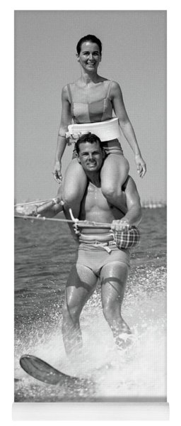 1960s Man Water Skiing With Woman Yoga Mat