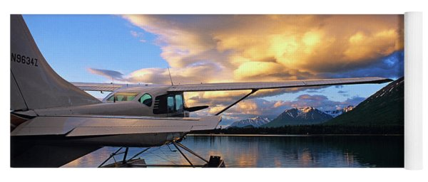 A Float Plane Sits Docked At Sunset Yoga Mat