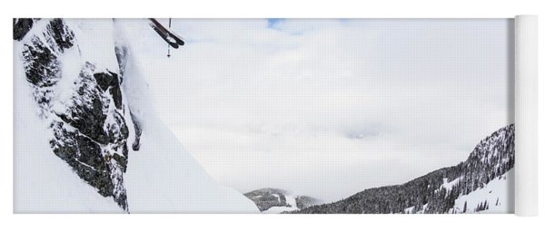 A Man Skis Deep Powder On A Stormy Day Yoga Mat