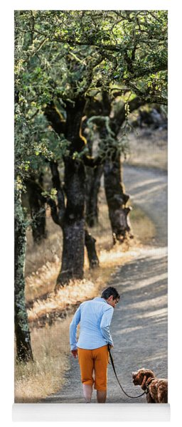 A Woman Takes Her Dog For A Walk Yoga Mat