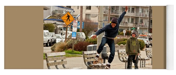 American Skateboarder In City Action Shot Yoga Mat