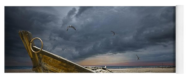 Boat With Gulls On The Beach With Oncoming Storm Yoga Mat