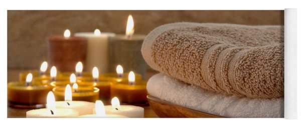 Candles And Towels In A Spa Yoga Mat
