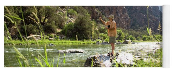 Fisherman Casts To Trout Yoga Mat