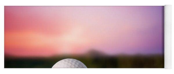 Golf Ball On Tee At Sunset Yoga Mat