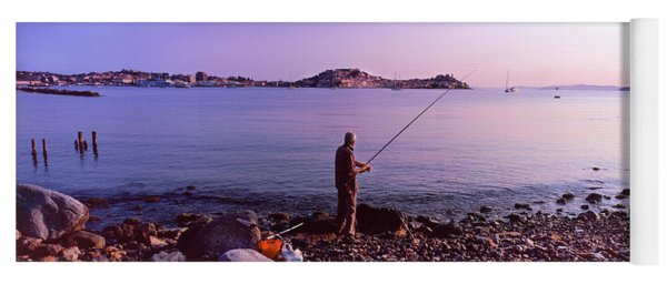Man Fishing At The Coast, Portoferraio Yoga Mat