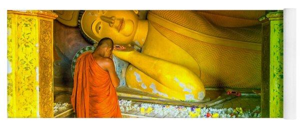 praying buddhist monk by a lying buddha in Sri Lanka Yoga Mat