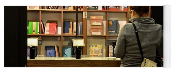 Woman Browses Kindle And Books At Bookshop Yoga Mat
