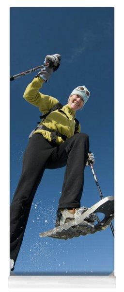 Woman Snowshoeing Below Mountain, San Yoga Mat
