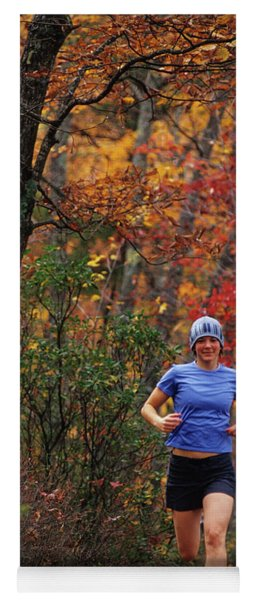 Woman Trai Lrunning In The Autumn Yoga Mat