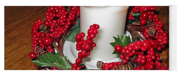 Christmas Composition. A White Candle And A Red Wreath Yoga Mat