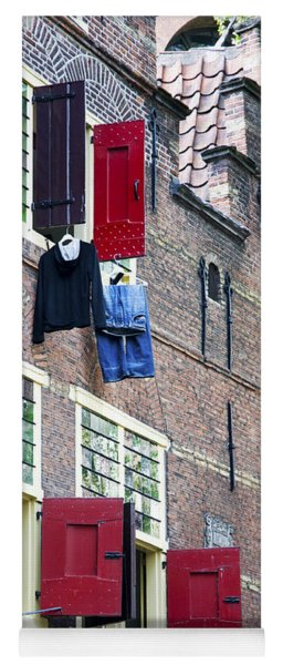 Clothes Hanging From A Window In Kattengat Yoga Mat