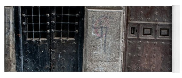 Yoga Mat featuring the photograph Medieval Doors Evil Graffiti by Lorraine Devon Wilke