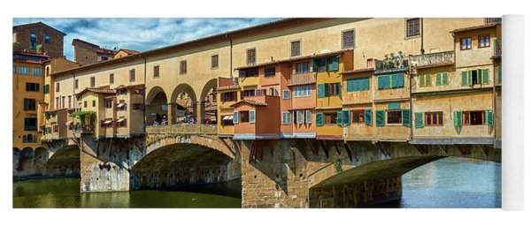 Ponte Vecchio On The Arno River Under A Blue Sky In Florence, Italy Yoga Mat