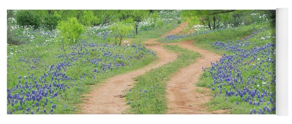 A Dirt Road Lined By Blue Bonnets Of Texas Yoga Mat