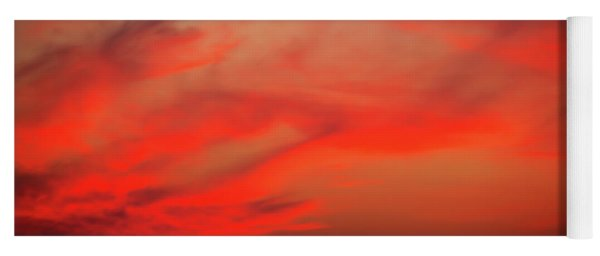 a gorgeous sunset with luminous red clouds over the Yala Nationalpark Yoga Mat