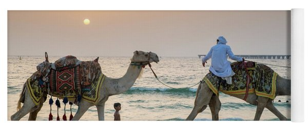 A Little Boy Stares In Amazement At A Camel Riding On Marina Beach In Dubai, United Arab Emirates Yoga Mat