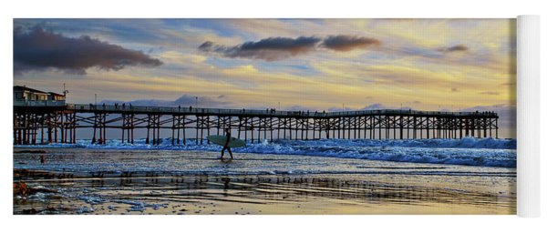 A Surfer Heads Home Under A Cloudy Sunset At Crystal Pier Yoga Mat