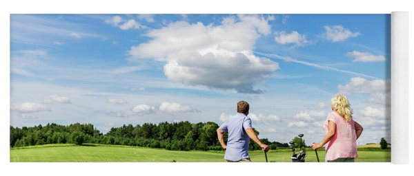 Active Senior Couple Playing Golf On A Course. Yoga Mat
