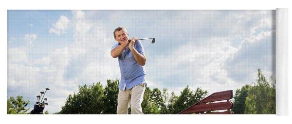 Active Senior Man Hitting A Golf Ball. Yoga Mat