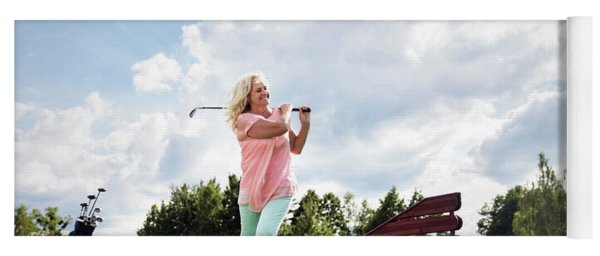 Active Senior Woman Playing Golf. Yoga Mat