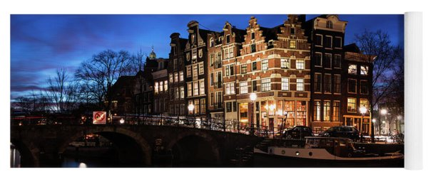 Yoga Mat featuring the photograph Amsterdam Canal Houses Illuminated At Dusk by IPics Photography
