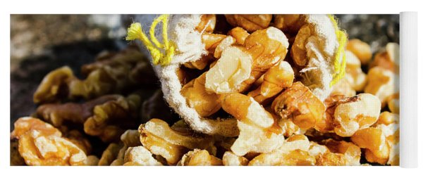 Closeup Of Walnuts Spilling From Small Bag Yoga Mat