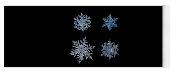 Yoga Mat featuring the photograph Four Snowflakes On Black Background by Alexey Kljatov