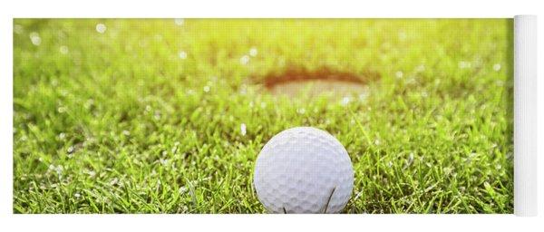 Golf Ball On A Grass. Sunshine Yoga Mat