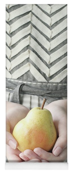 Hands Holding Yellow Pear Yoga Mat