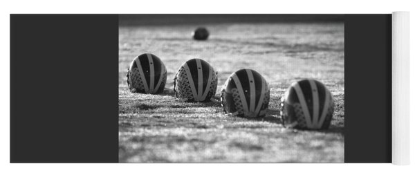 Helmets On Dew-covered Field At Dawn Black And White Yoga Mat