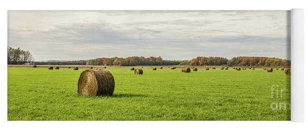 Large, Round, Bales Of Hay Under A Blue Sky With Clouds Yoga Mat
