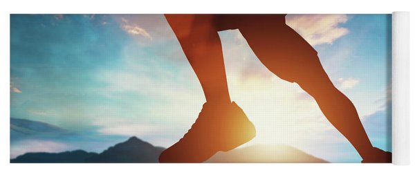 Man Running In The Mountains At The Sunset. Yoga Mat