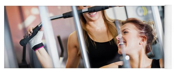 Personal Trainer Helps With Gym Equipment Workout. Yoga Mat