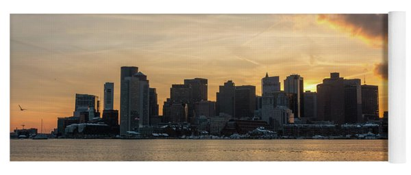 Seagull Flying At Sunset With The Skyline Of Boston On The Backg Yoga Mat
