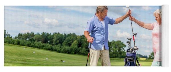 Senior Couple Choosing Equipment For A Golf Game. Yoga Mat