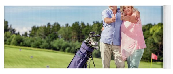 Senior Couple Giving Thumbs Up On A Golf Course. Yoga Mat