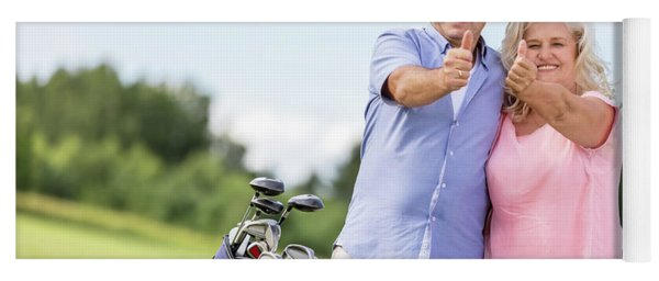 Senior Couple Showing Ok Sign On A Golf Course. Yoga Mat