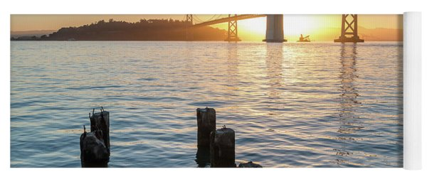 Six Pillars Sticking Out The Water With Bay Bridge In The Backgr Yoga Mat