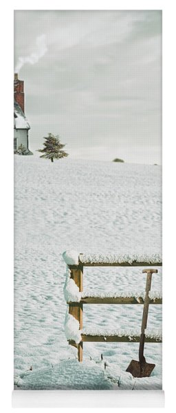 Spade Leaning Against Fence In The Snow Yoga Mat