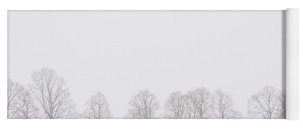 Trees In A White Landscape In A Blizzard Yoga Mat